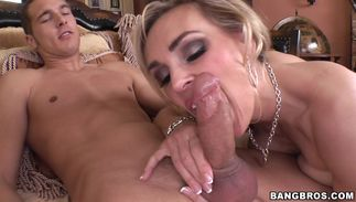 Heavenly busty golden-haired playgirl Tanya Tate works her mouth and tits on a hard dick