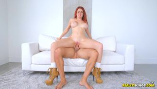 Racy big boobed redhead Skyla Novea seems innocent but rides packing monster like a pro
