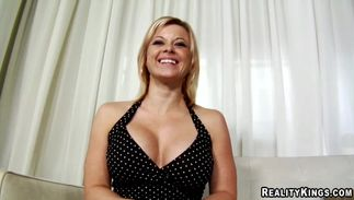Slutty busty blond Raychelle smiles at the thought that she's gonna be fucked